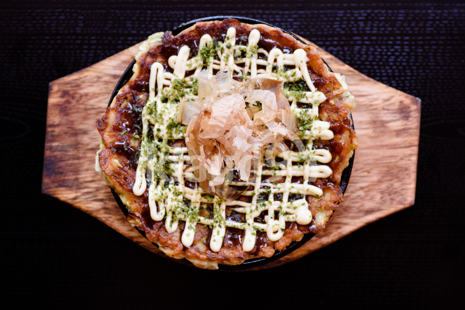 Okonomiyaki in a hot plate