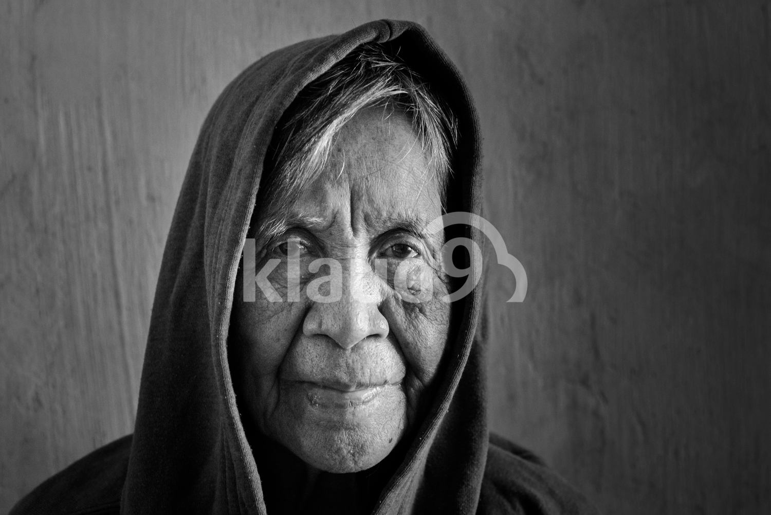 Grandma with a hood in black and white