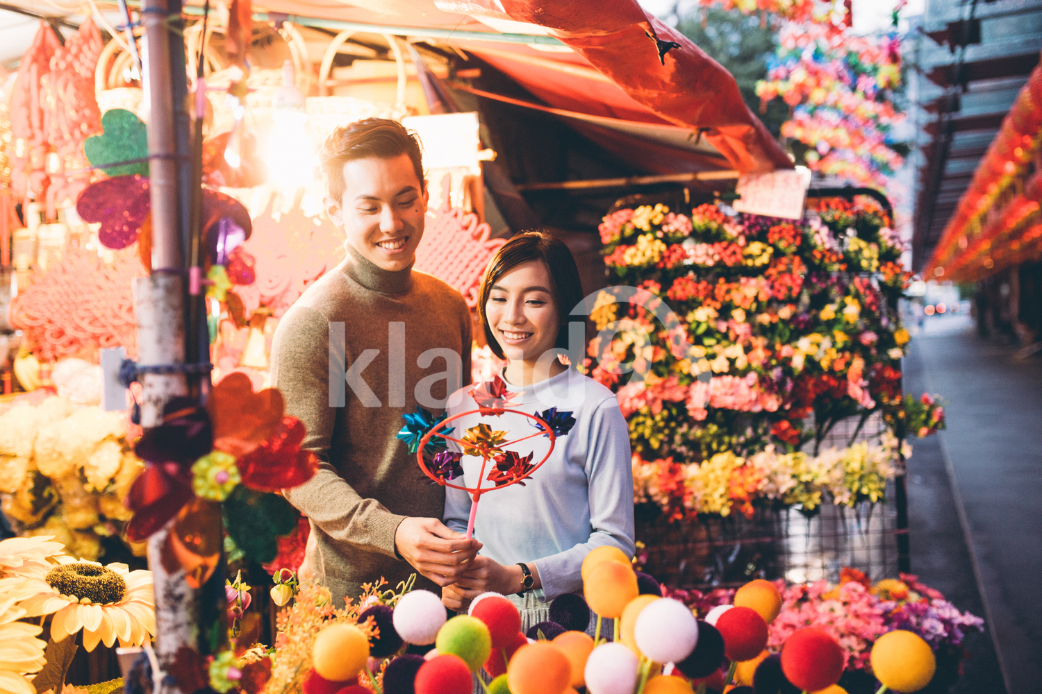 Young couple buying Chinese New Year flowers