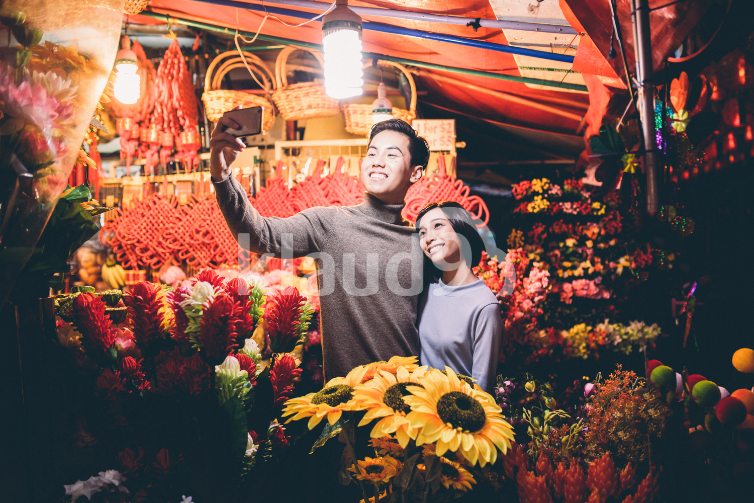 Young Chinese couple taking selfies in Chinatown