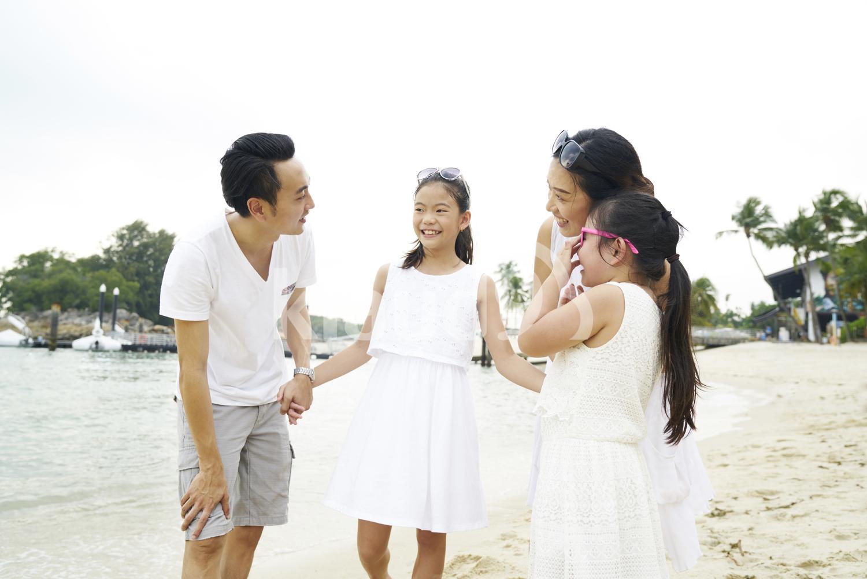 Family of four bonding on Sentosa beach