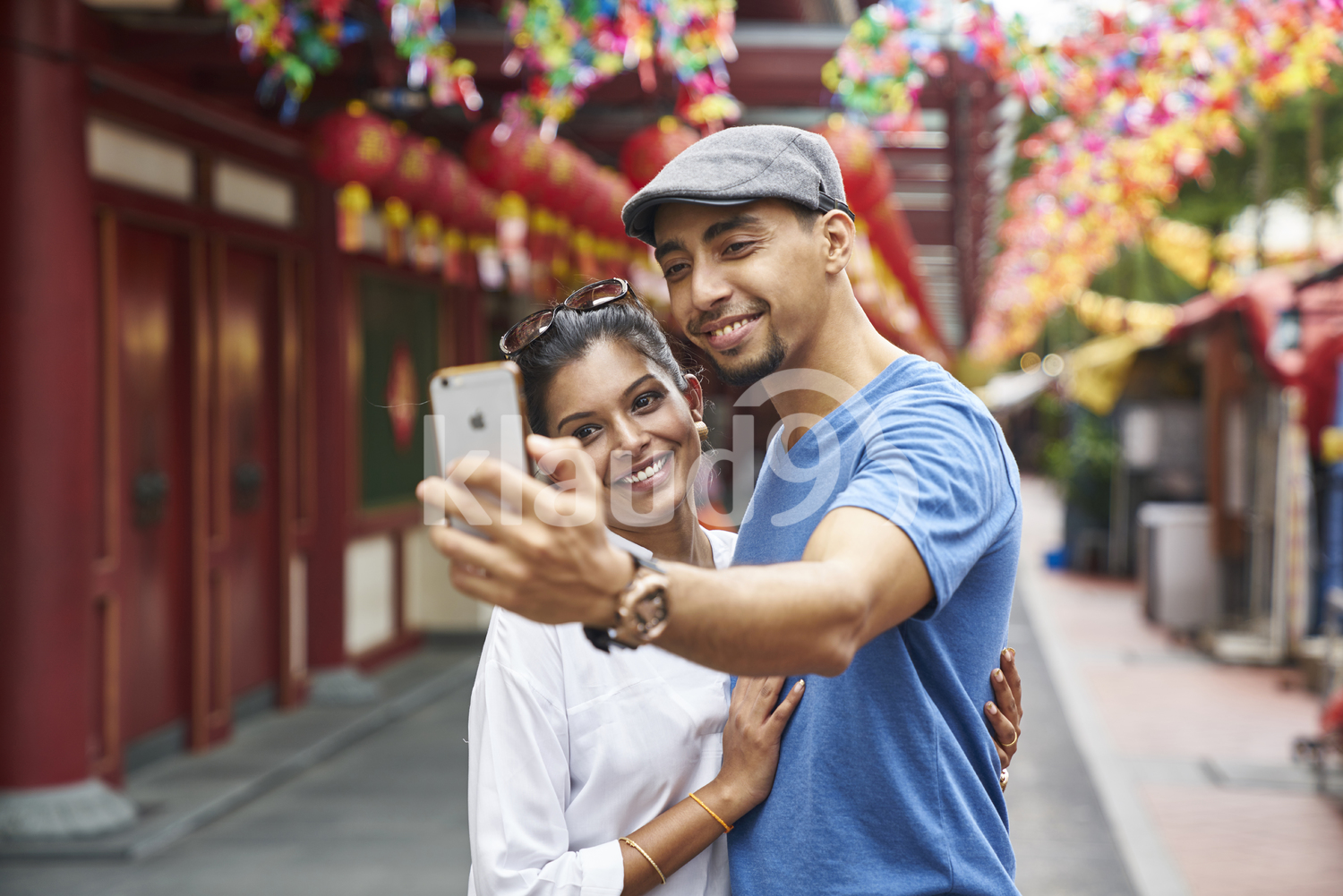 Beautiful young couple taking a selfie in Chinatown