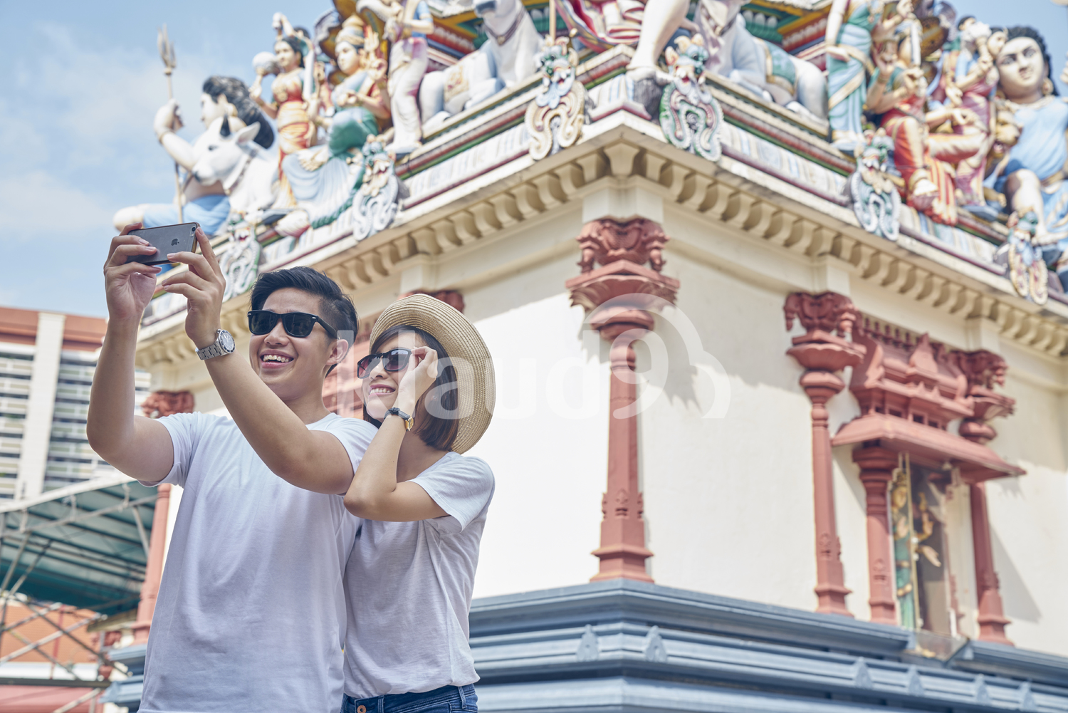 Happy couple taking a selfie in Sri Mariamman Temple, Singapore