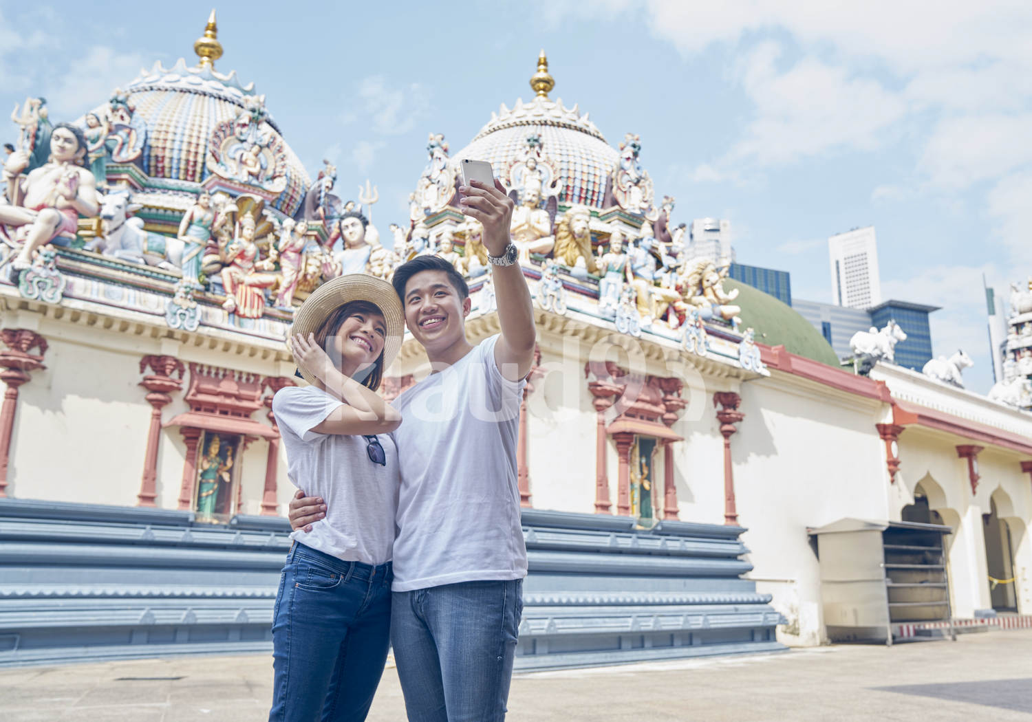 Cheerful tourists taking a selfie in Sri Mariamman Temple, Singapore