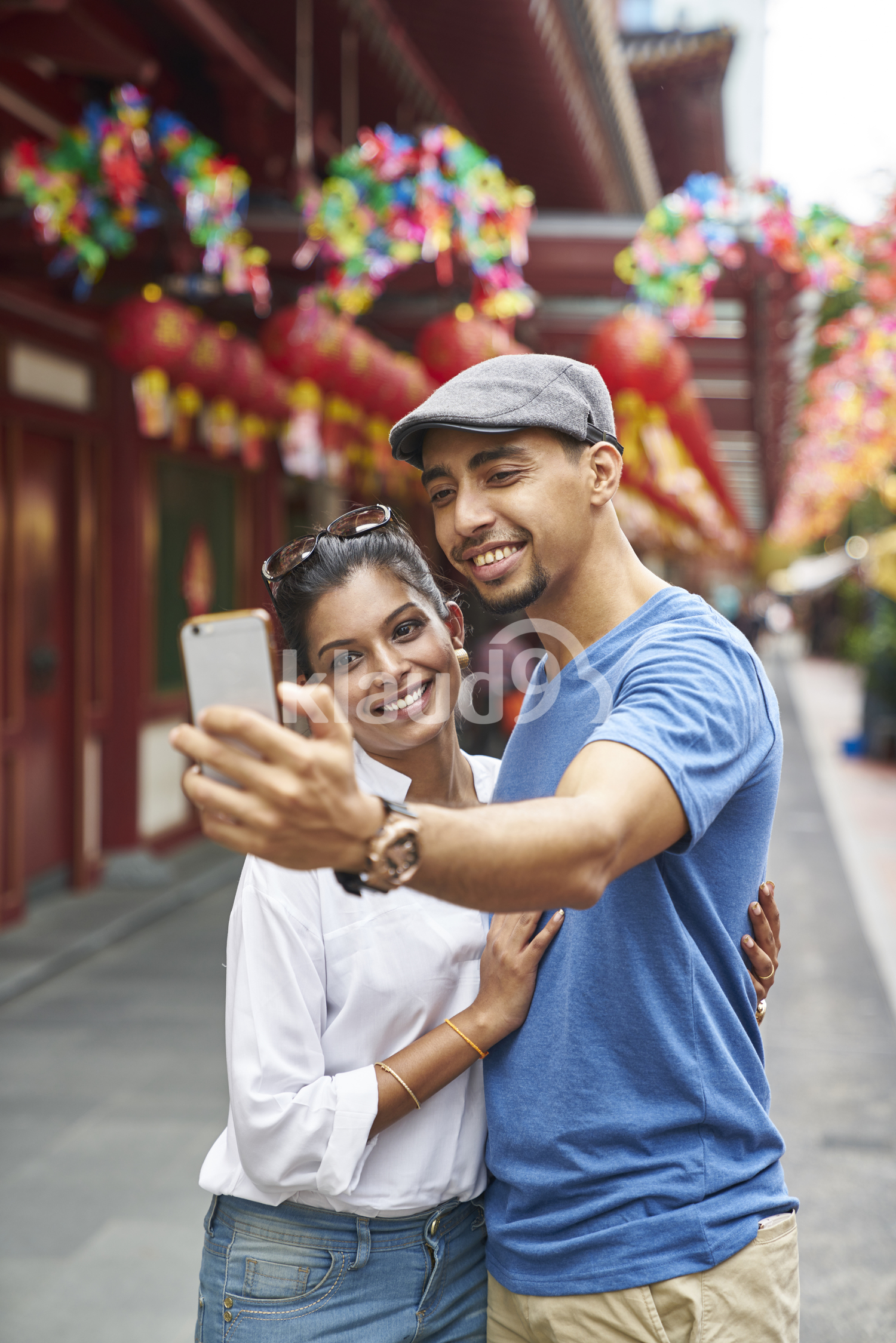Beautiful couple taking a selfie in Chinatown
