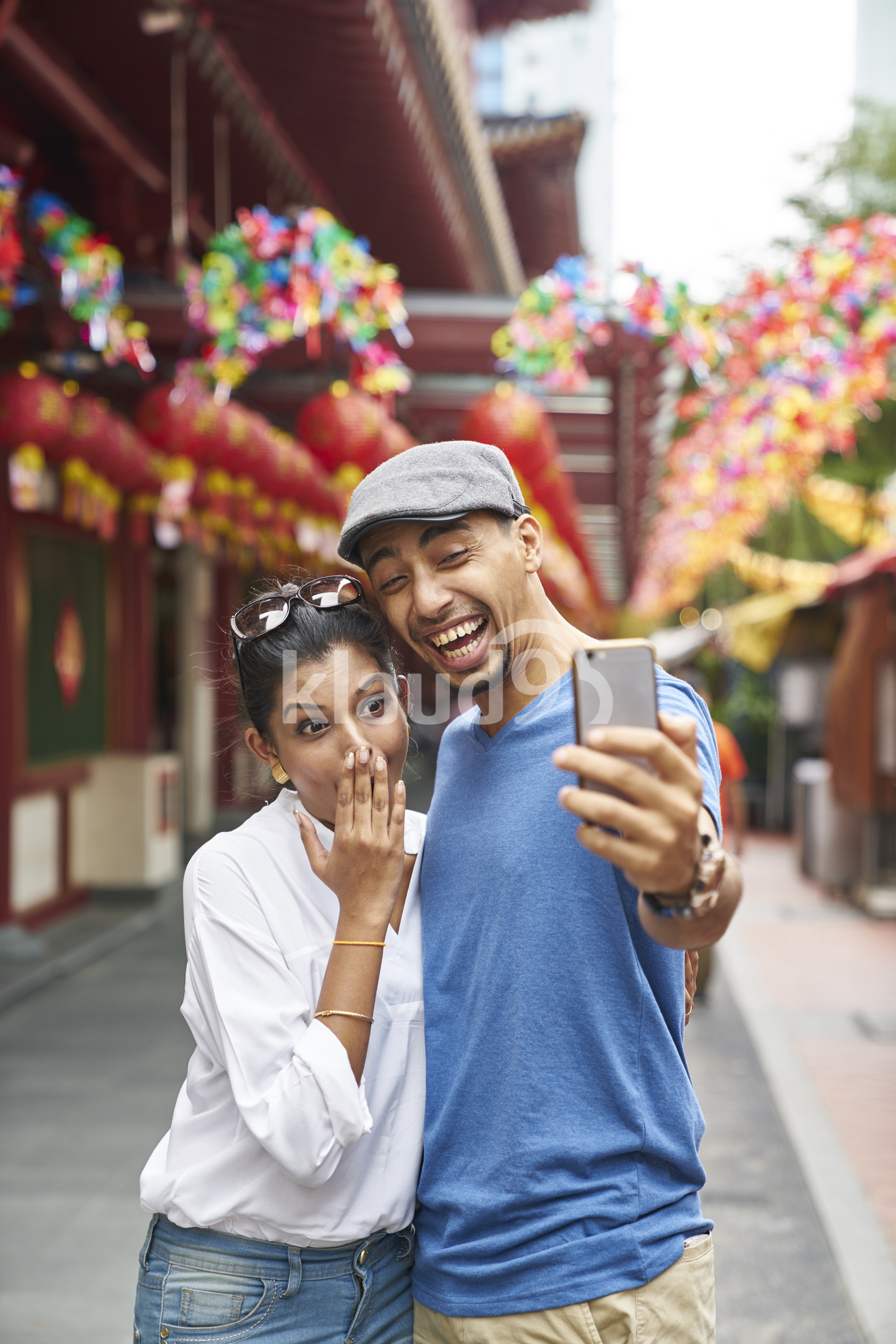 Young couple taking a selfie in Chinatown