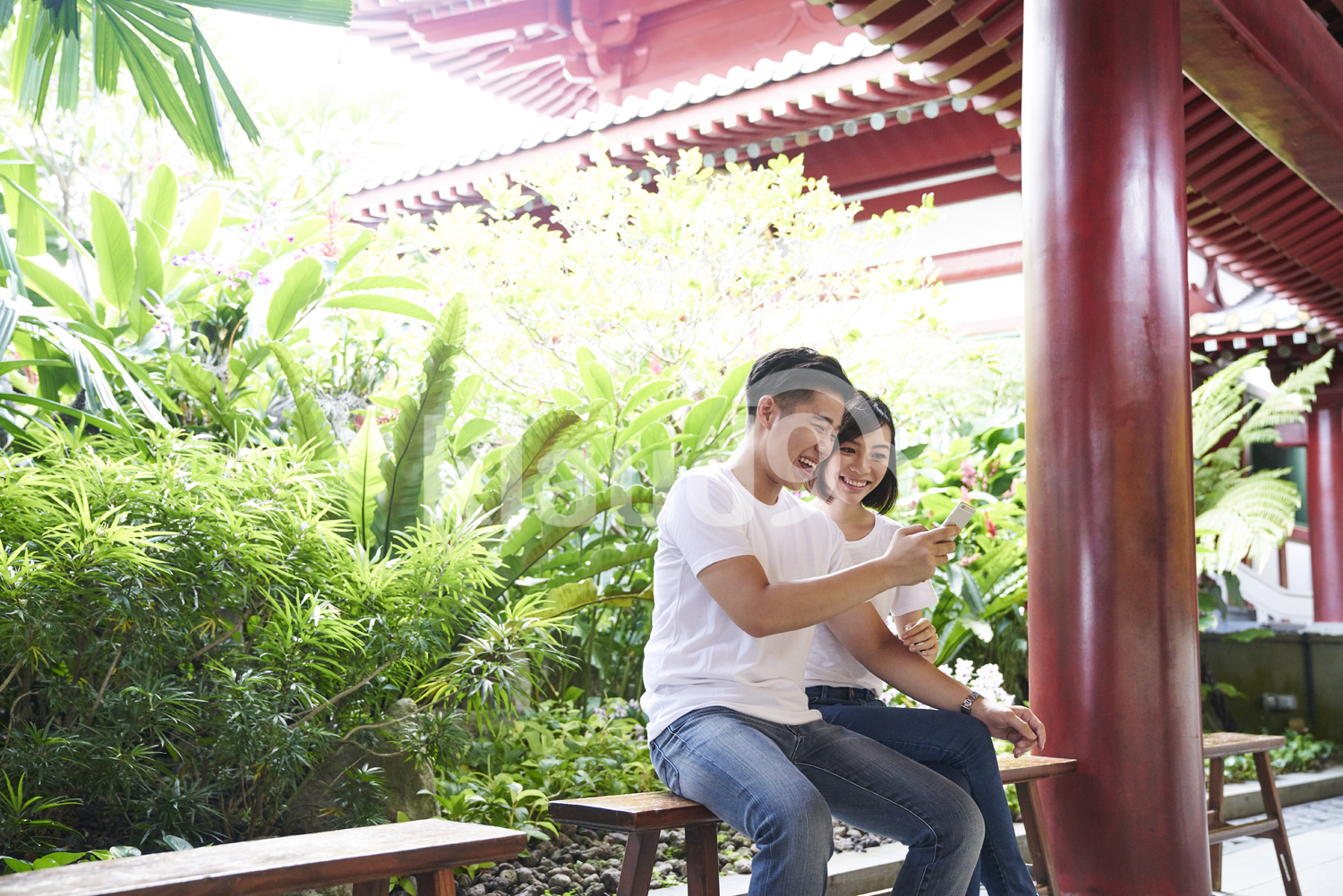 Cheerful tourists taking a break inside Buddha Tooth Relic Temple