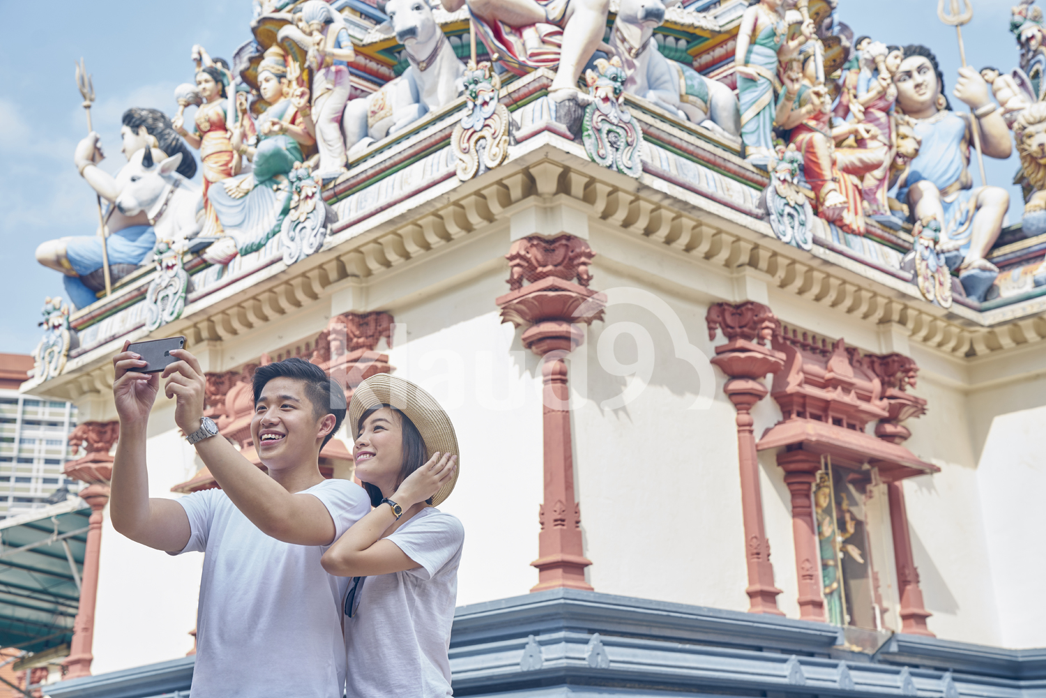 Happy tourists taking a selfie in Sri Mariamman Temple, Singapore