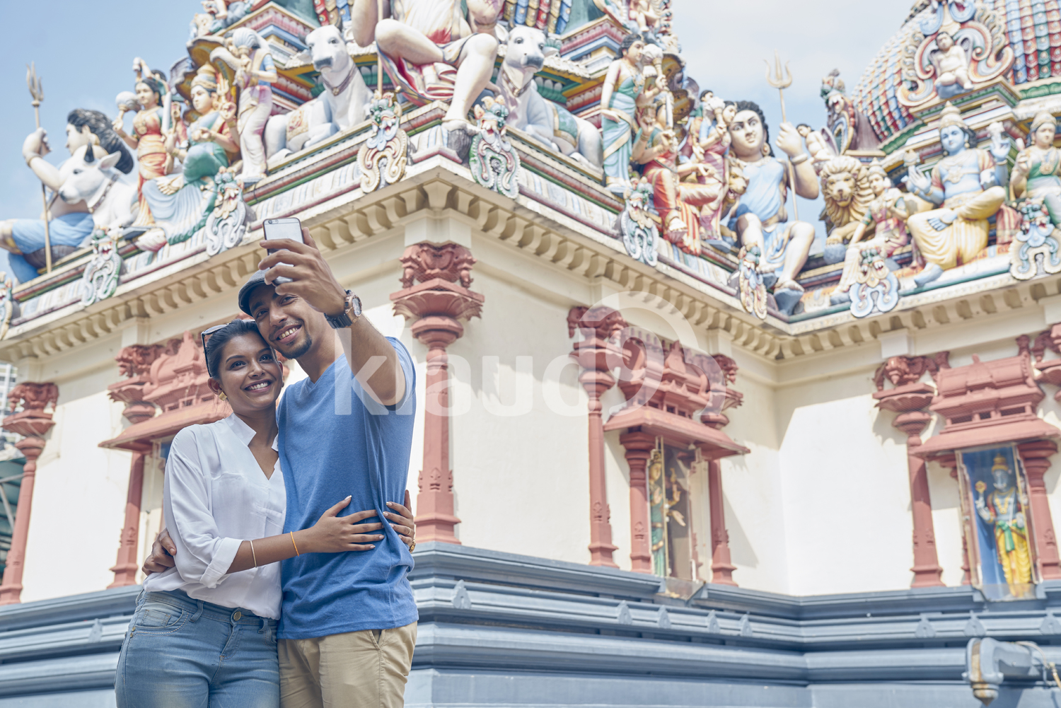 Beautiful young couple taking a selfie in Sri Mariamman Temple, Singapore