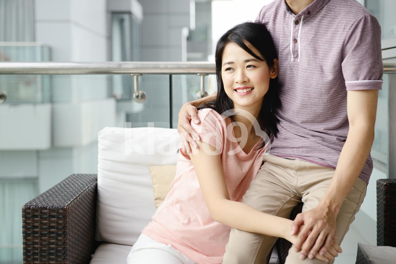 Woman hugging her husband on a condo balcony
