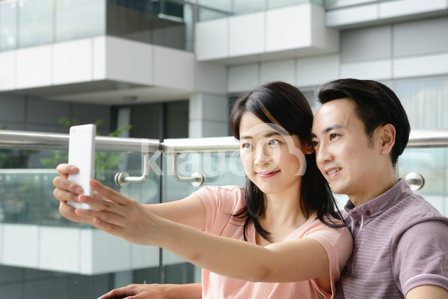 Couple taking a selfie outside their condo