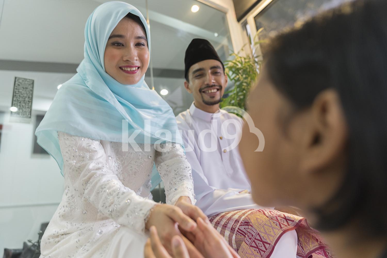 Young girl seeking forgiveness from her beautiful parents