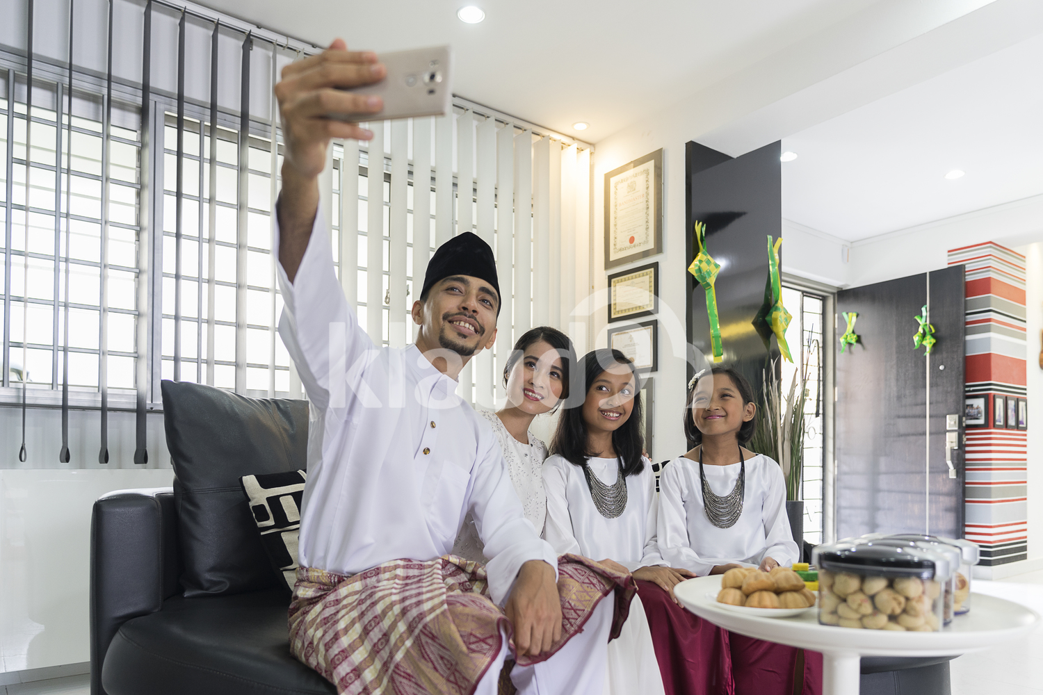 Family taking Hari Raya selfie