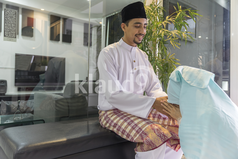 Wife in a Hijab seeking forgiveness from her husband