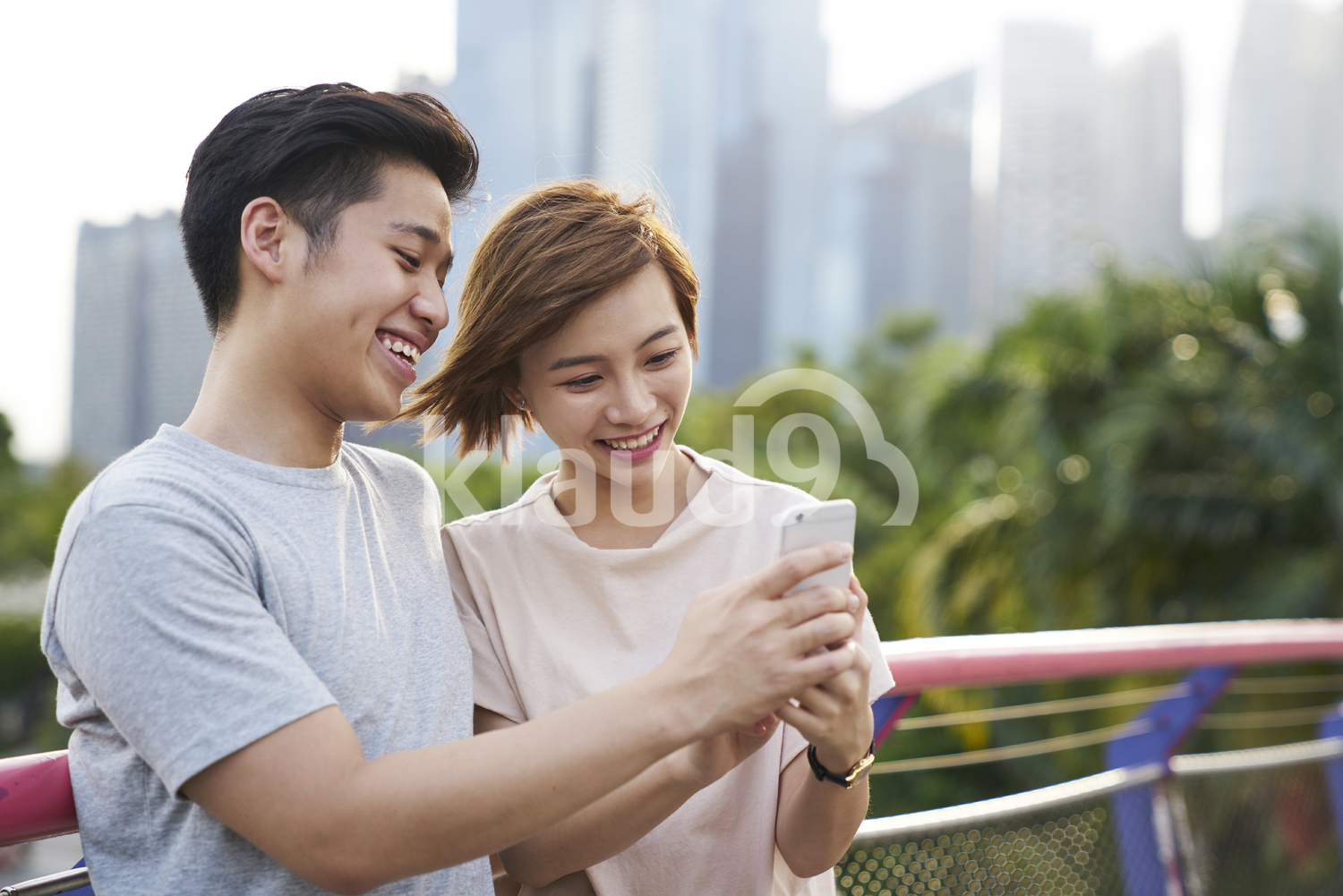 Smiley young couple taking a selfie at Gardens by the Bay, Singapore