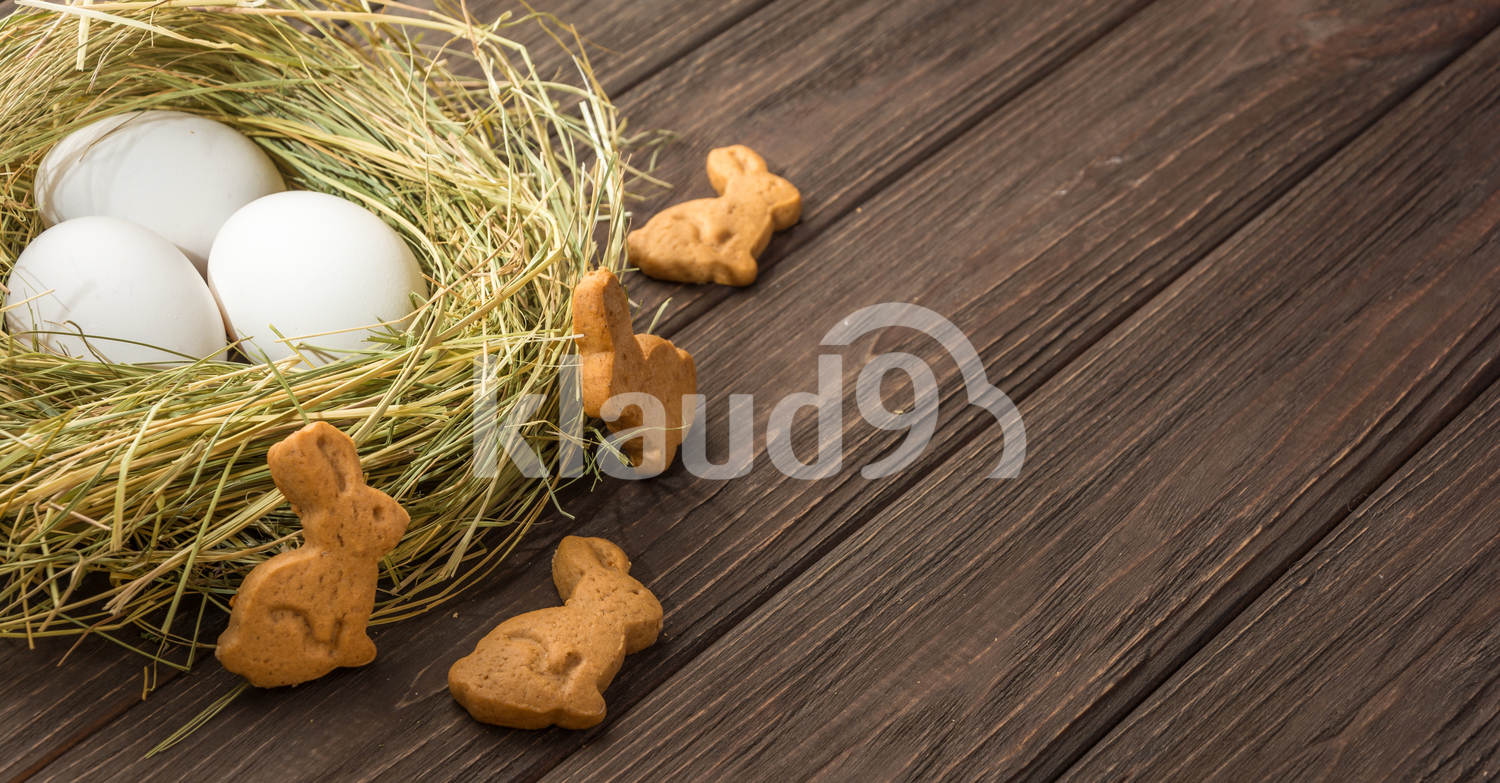 Easter eggs in a straw nest and cookies