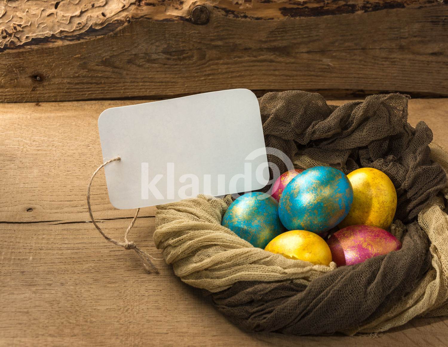 Easter eggs nestled on a natural wooden background