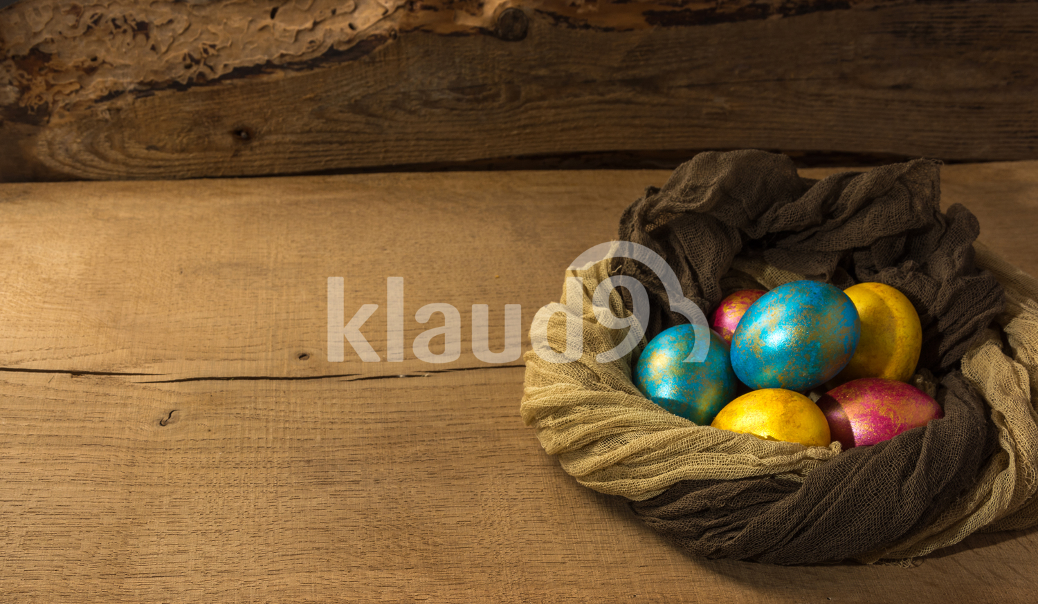 Easter eggs on a natural wooden background