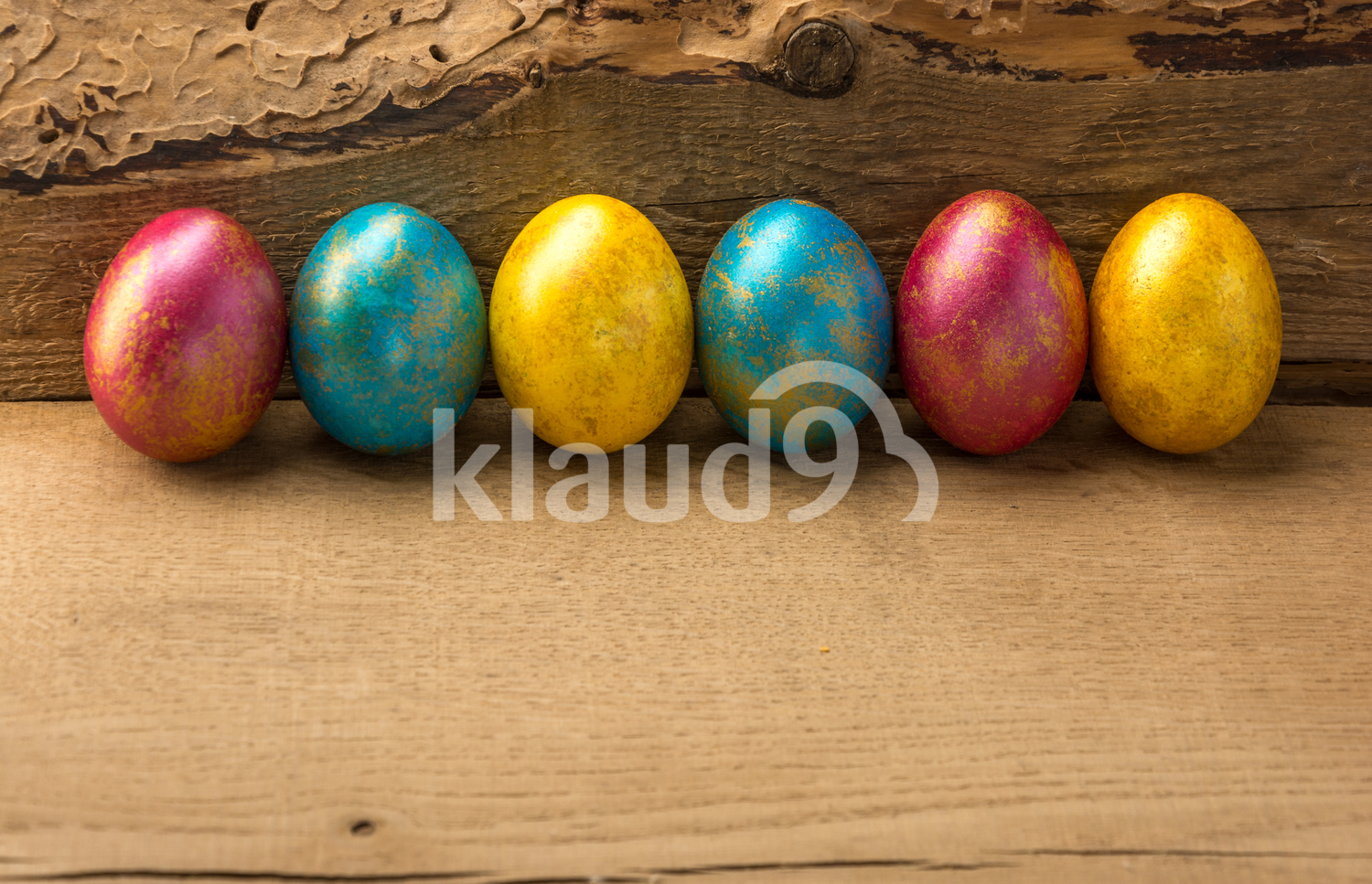 Colourful Easter eggs on a wooden background