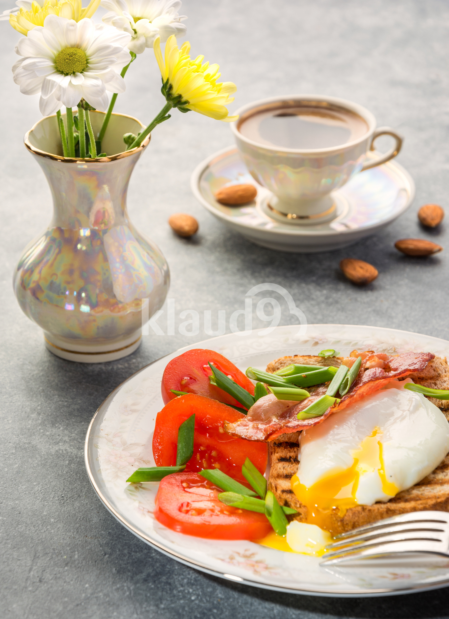 Breakfast with egg poached, toasted, bacon, tomatoes and coffee