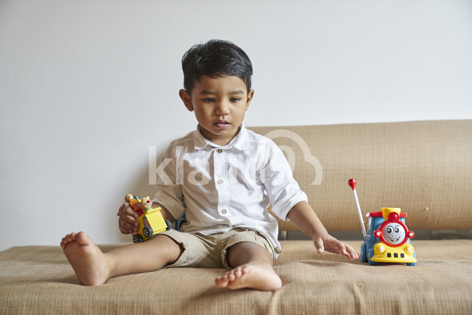 Little boy playing on the sofa