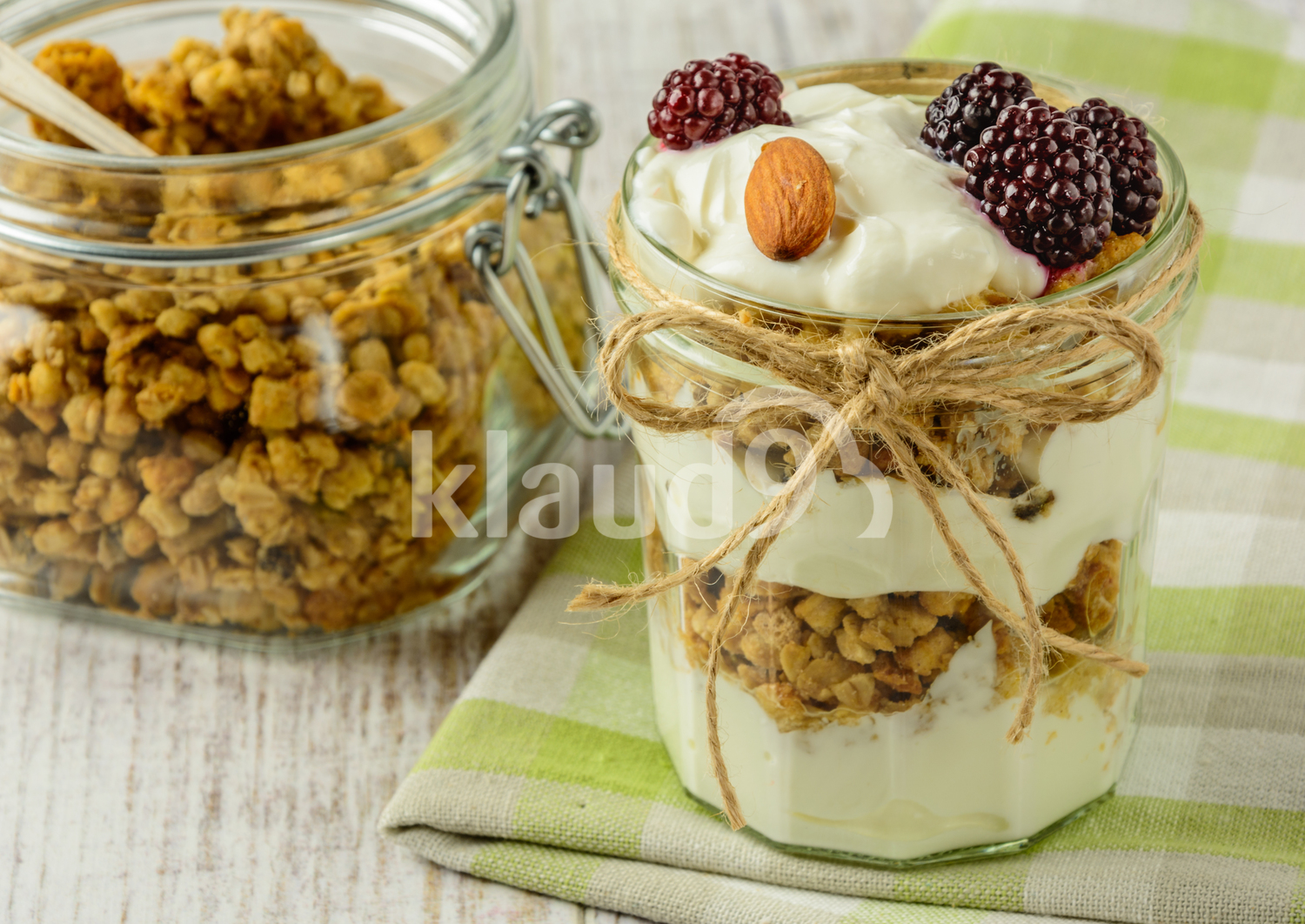 Healthy breakfast ingredients on a white wooden table.