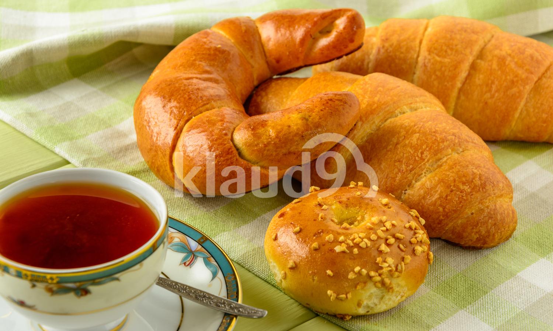 Healthy breakfast ingredients on a light green wooden table.