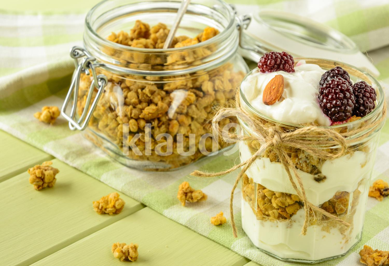 Healthy breakfast ingredients on a light green wooden table