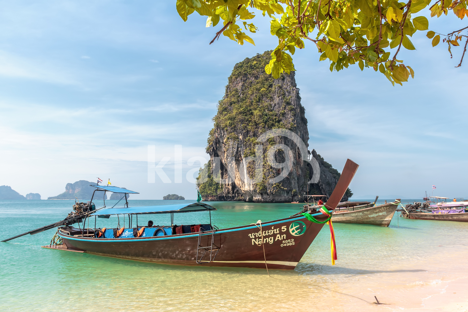 Kingdom of Thailand. Traditional Thai longtail boats. Krabi Province, Railay Peninsula, Phranang Cave Beach