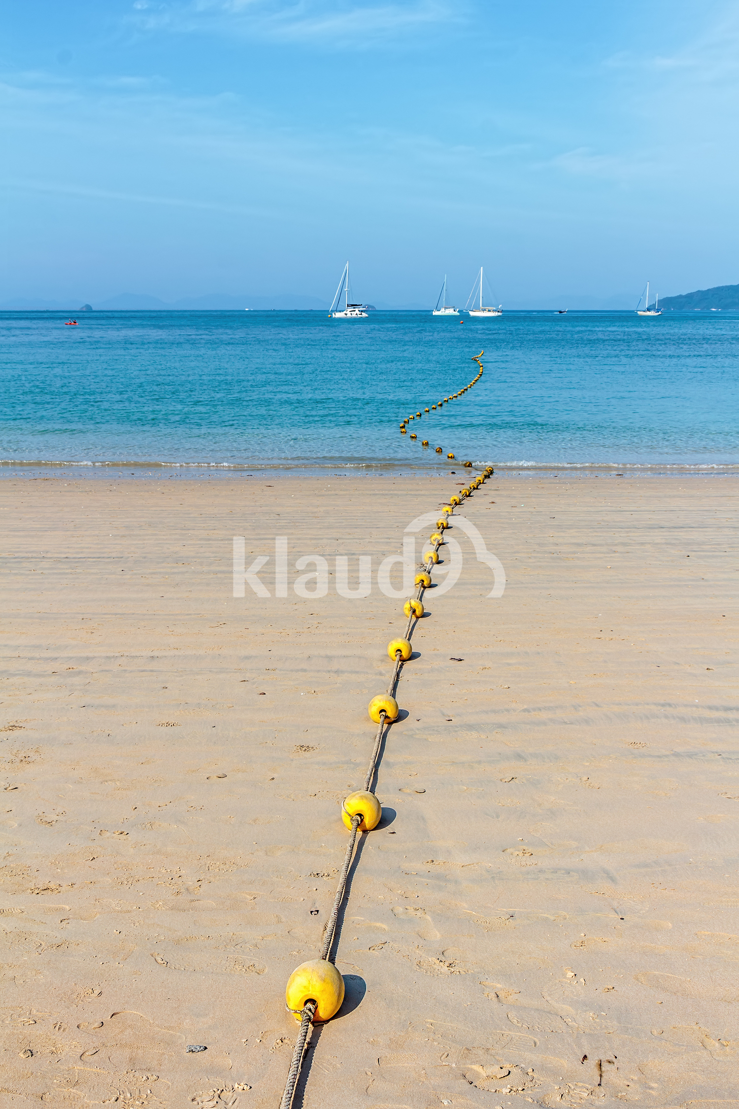 Tropical sandy beach and white yachts in the sea. Kingdom of Thailand, Krabi Province, Railay Peninsula, Railay West Beach