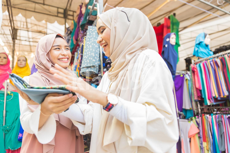 Two Muslim women at a Hari Raya Bazaar in Singapore
