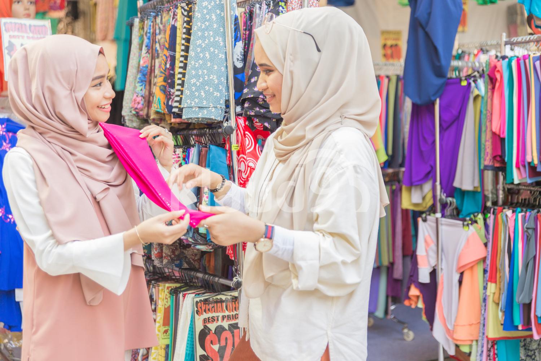 Young muslim women in fabric shop