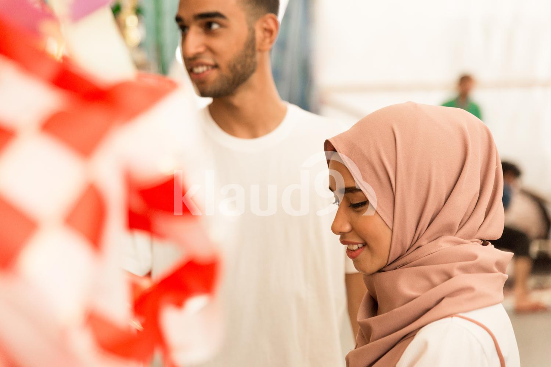 Muslim couple shopping during Hari Raya