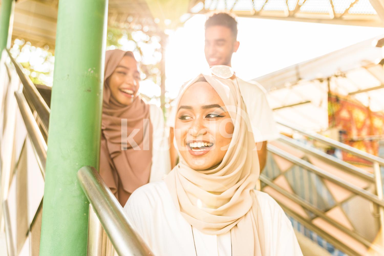 Group of happy Muslim friends