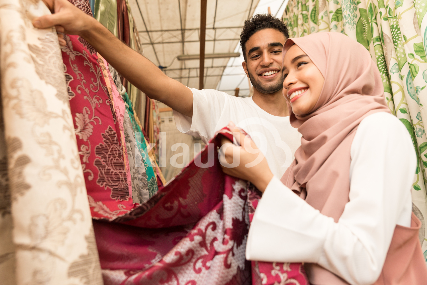 Young couple shopping for fabric