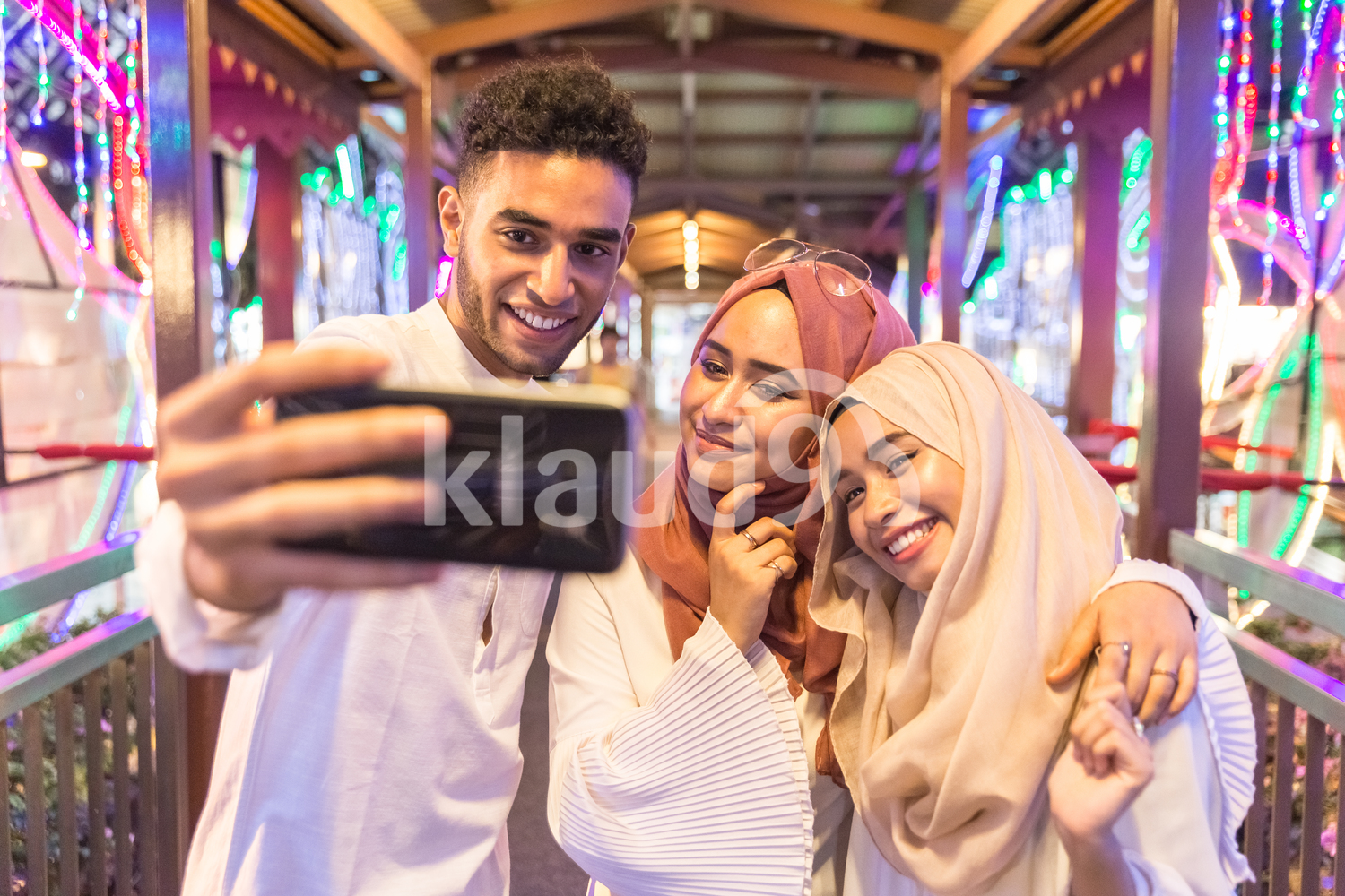 Close up of young muslim friends taking a selfie