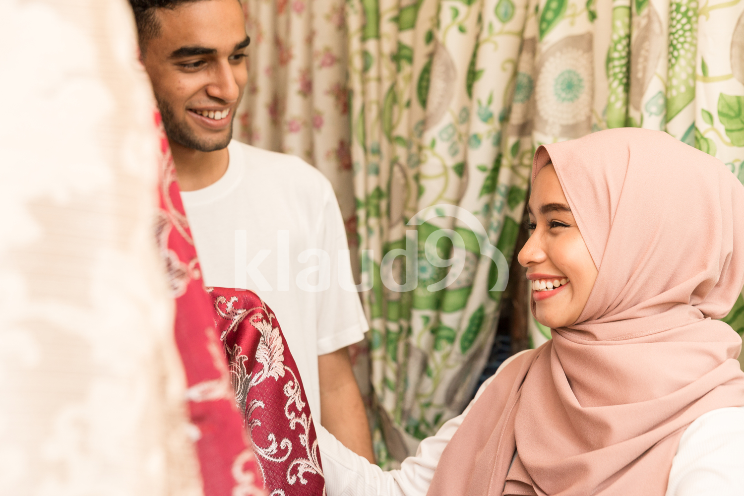 Muslim couple shopping for fabric