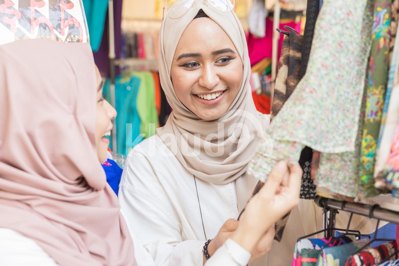 Young muslim women shopping for Hari Raya at a bazaar