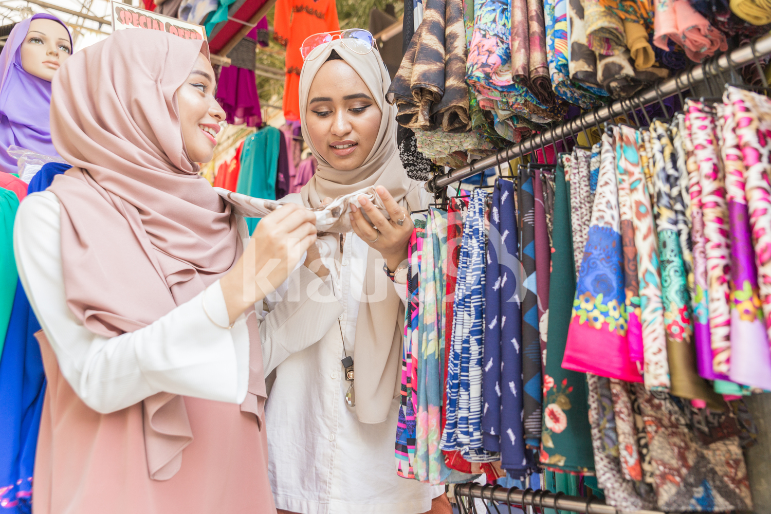 Young muslim women shopping for headscarves