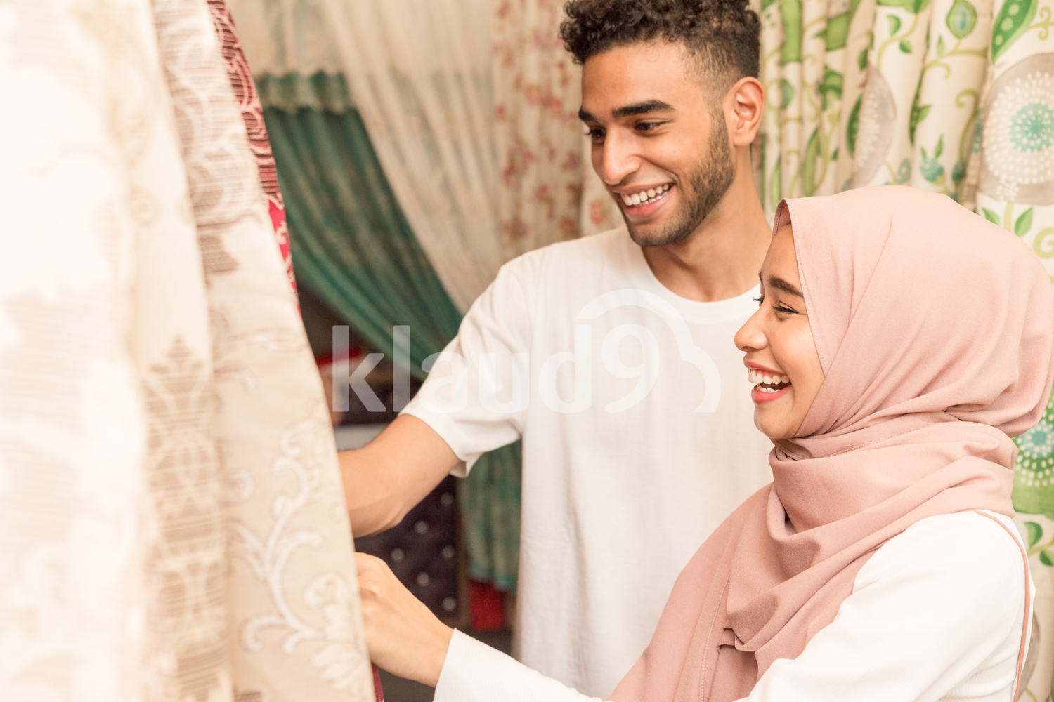 Young couple shopping for fabrics