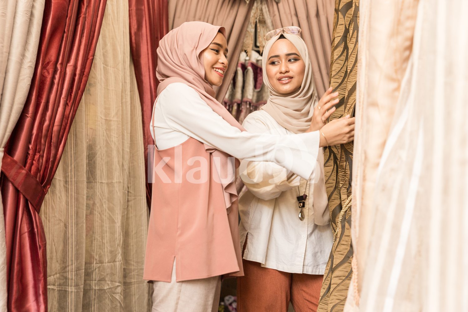 Two muslim women shopping for curtains