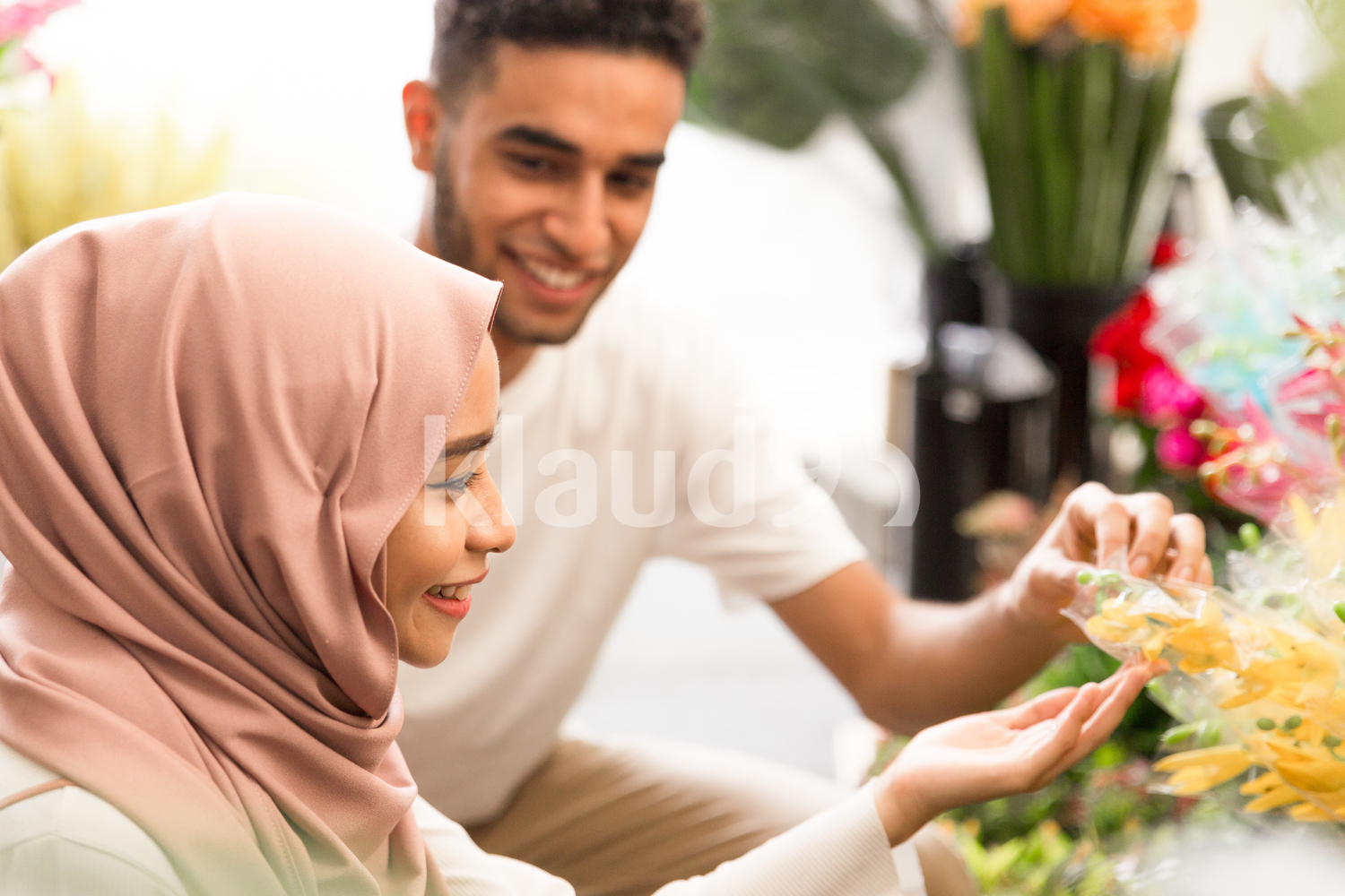 Young couple admiring flowers