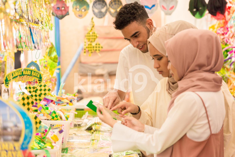 Three Muslim friends shopping for Hari Raya
