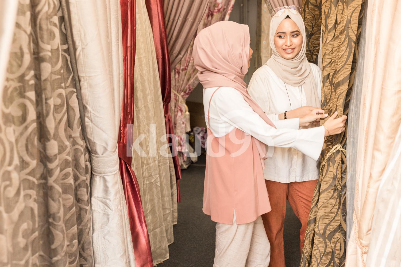 Two muslim women shopping for Hari Raya