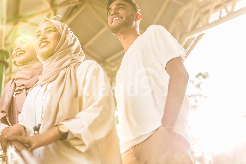 Three muslim friends smiling