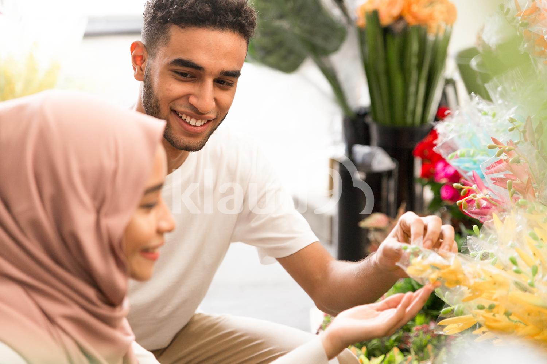 Couple admiring flowers