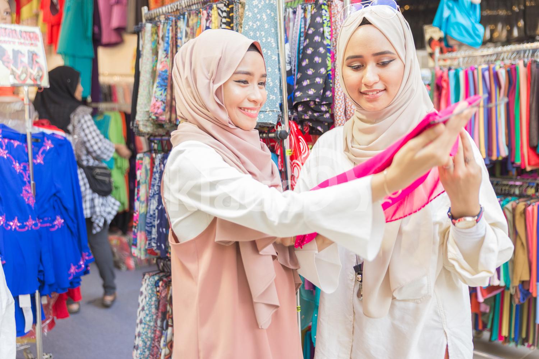 Two muslim women in fabric shop