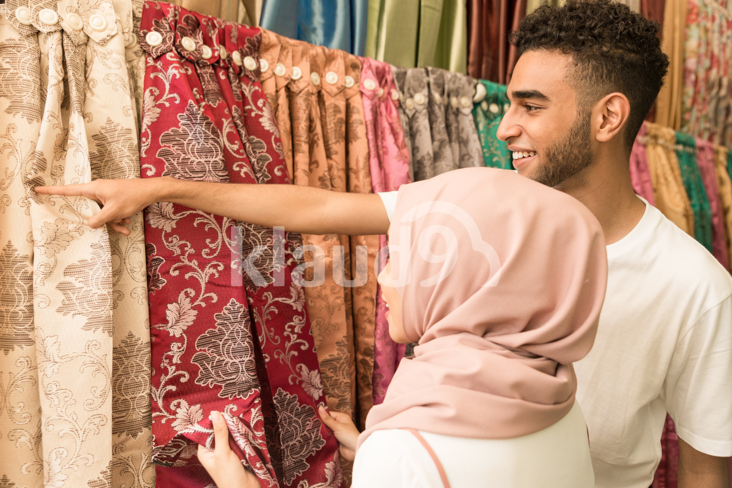 Young couple in fabric store