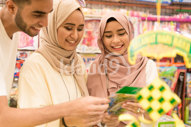 Muslim friends shopping for Hari Raya smiling