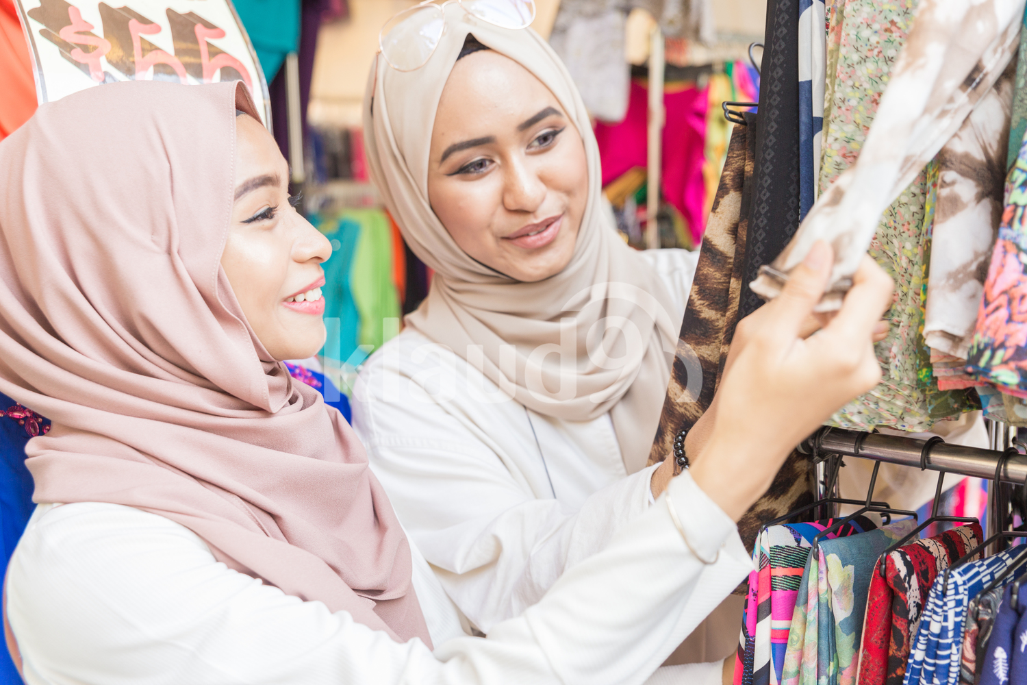 Two muslim women shopping for scarves